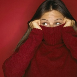 woman-hiding-in-sweater-w352