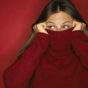 woman-hiding-in-sweater-w352